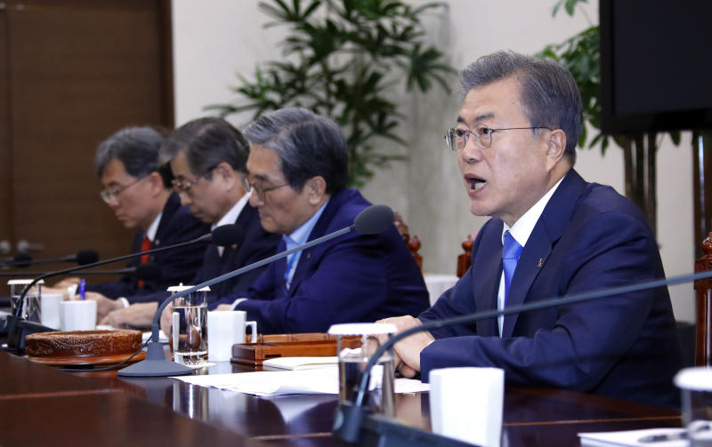 South Korean President Moon Jae-in, right, presides over a meeting of the National Security Council at the presidential Blue House in Seoul, South Korea, Monday, March 4, 2019. Moon said Seoul will actively try to get the nuclear negotiations between Washington and Pyongyang quickly back on track. (Bae Jae-man/Yonhap via AP)