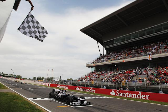 BARCELONA, SPAIN - MAY 13: Pastor Maldonado of Venezuela and Williams crosses the finishing line to win the Spanish Formula One Grand Prix at the Circuit de Catalunya on May 13, 2012 in Barcelona, Spain. (Photo by Mark Thompson/Getty Images)