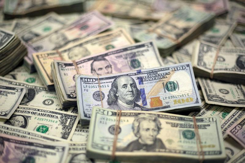 U.S. Dollar banknotes are seen in this photo illustration