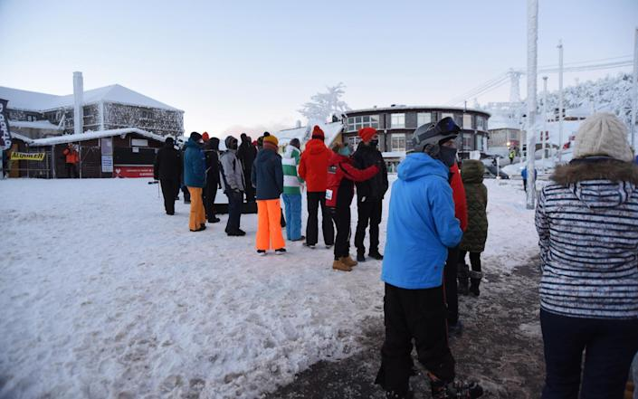 People queue up at the ski resort at the Navacerrada mountain pass in Madrid - Shutterstock