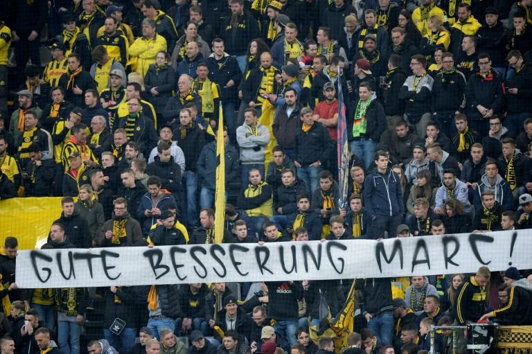 "Borussia Dortmund fans held a banner reading ""Get well Marc"" during their Champions League quarter-final match with Monaco in western Germany, on April 12, 2017"