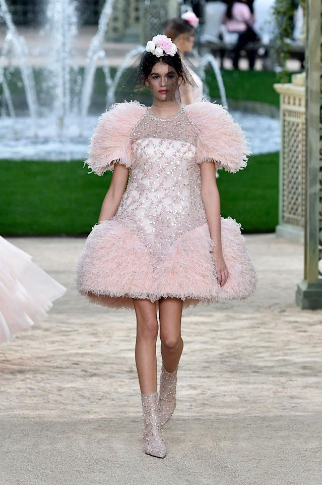 <p>Kaia Gerber makes her couture debut wearing a pink feather-and-crystal dress from the Chanel SS18 Haute Couture show. (Photo: Getty Images) </p>