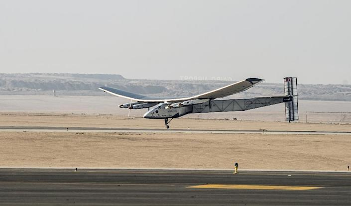 Solar Impulse 2 lands at Cairo International Airport on July 13, 2016, for the penultimate stage of its world tour (AFP Photo/Khaled Desouki)