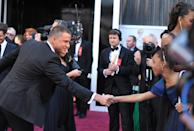 Actors Channing Tatum, left, and Quvenzhane Wallis greet each other as they arrive at the 85th Academy Awards at the Dolby Theatre on Sunday Feb. 24, 2013, in Los Angeles. (Photo by John Shearer/Invision/AP)