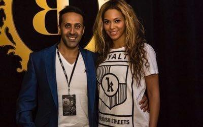 Mansoor Hussain posing with Beyonce