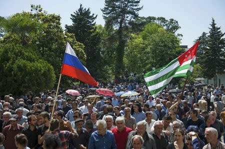 Opposition protesters gather outside the presidential headquarters in Sukhumi, the capital of Georgia's breakaway region of Abkhazia, in this May 28, 2014 file picture. REUTERS/Nina Zotina/Files