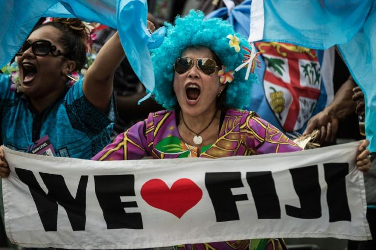 A Fiji supporter cheers during their match against New Zealand at the Hong Kong Rugby Sevens tournament