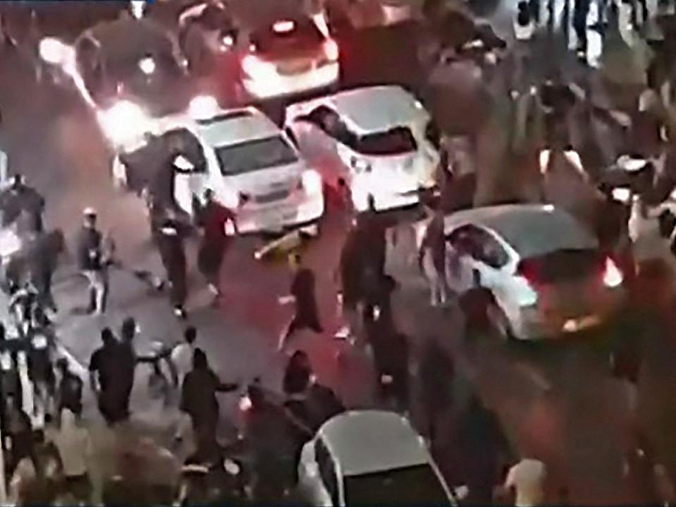 A far-right Israeli mob have attacked a man they believed to be an Arab, dragging him from his car and beating him unconscious (Kan 11 public proadcaster/AFP via Getty Images)