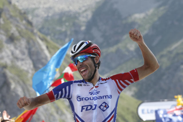 France's Thibaut Pinot celebrates as he crosses the finish line to win the fourteenth stage of the Tour de France cycling race over 117.5 kilometers (73 miles) with start in Tarbes and finish at the Tourmalet pass, France, Saturday, July 20, 2019. (AP Photo/ Thibault Camus)
