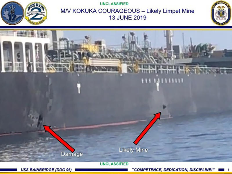 FILE - This June 13, 2019 file image, released by the U.S. military's Central Command, shows damage and a suspected mine on the Kokuka Courageous in the Gulf of Oman near the coast of Iran. A series of attacks on oil tankers near the Persian Gulf has ratcheted up tensions between the U.S. and Iran -- and raised fears over the safety of one of Asia's most vital energy trade routes, where about a fifth of the world's oil passes through its narrowest at the Strait of Hormuz. (U.S. Central Command via AP, File)