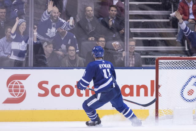 Toronto Maple Leafs' Zach Hyman looks up at celebrating ans after scoring on an empty net to record his team's fourth goal during third-period NHL hockey game action against the Boston Bruins in Toronto, Monday, Nov. 26, 2018. (Chris Young/The Canadian Press via AP)