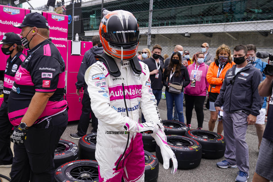 Helio Castroneves, of Brazil, prepares to drive during the final practice for the Indianapolis 500 auto race at Indianapolis Motor Speedway in Indianapolis, Friday, May 28, 2021. (AP Photo/Michael Conroy)
