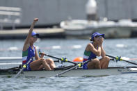 Valentina Rodini and Federica Cesarini of Italy react after competing in the lightweight women's rowing double sculls final at the 2020 Summer Olympics, Thursday, July 29, 2021, in Tokyo, Japan. (AP Photo/Lee Jin-man)