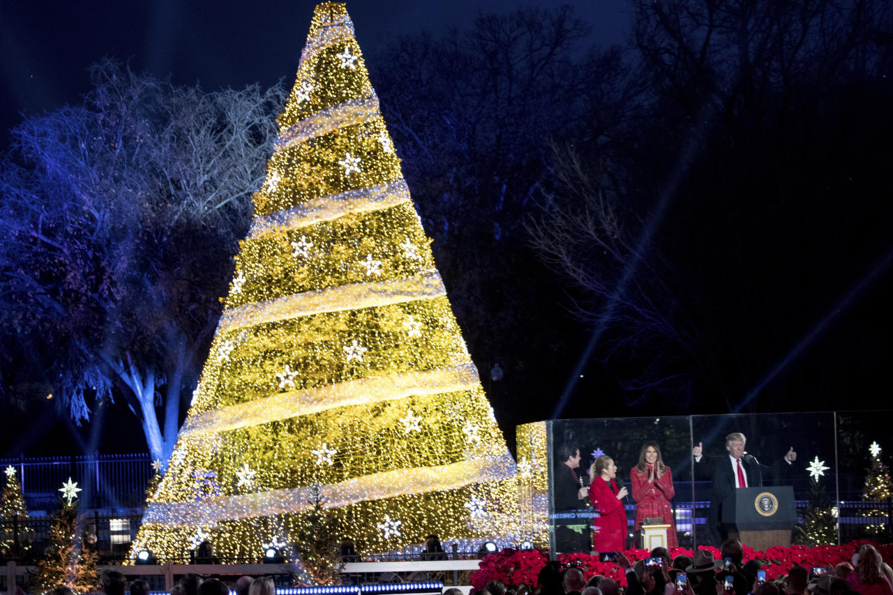 <p>President Donald Trump and first lady Melania Trump, react as they light the 2017 National Christmas Tree during the National Christmas Tree lighting ceremony at the Ellipse near the White House in Washington, Thursday, Nov. 30, 2017. (Photo: Andrew Harnik/AP) </p>