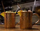 <p>This <span>Moscow-Mix Moscow Mule Copper Mugs</span> ($26) comes with cups, cocktail mix, and a shot glass.</p>