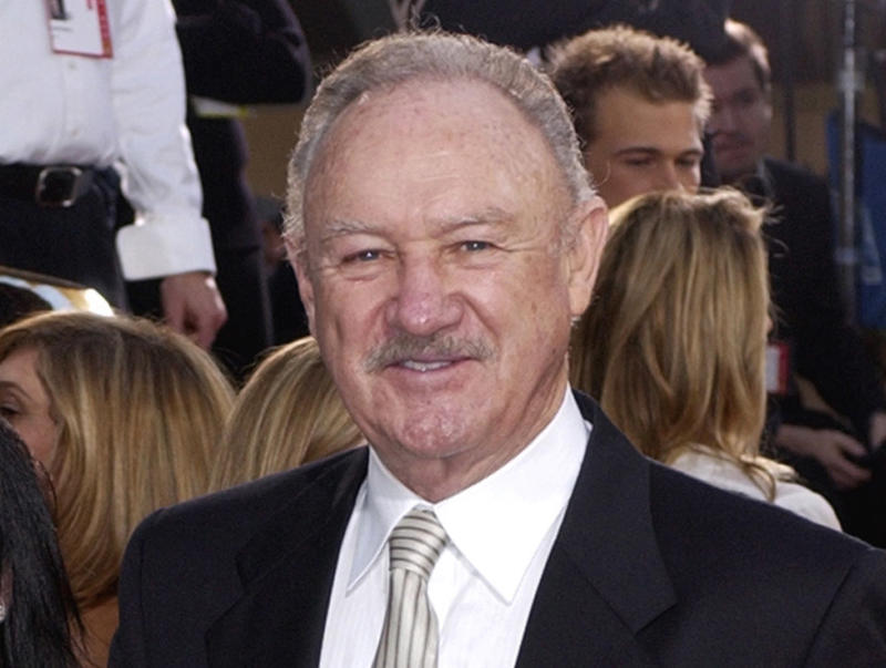 FILE - This Jan. 19, 2003 file photo shows actor Gene Hackman at the 60th Annual Golden Globe Awards in Beverly Hills, Calif. A New Mexico police report says Gene Hackman had given clothes, money and rides to a homeless man he slapped this week after the man became aggressive toward the Oscar-winning actor and his wife. The Santa Fe New Mexican reports  Hackman and his wife told officers they had helped 63-year-old Bruce Becker for several years. The Santa Fe police report says Hackman rebuffed Becker when he approached them Tuesday, Oct. 30, 2012, and told him to get a job. Police say Hackman acted in self-defense and no charges have been filed.  (AP Photo/Mark J. Terrill, file)