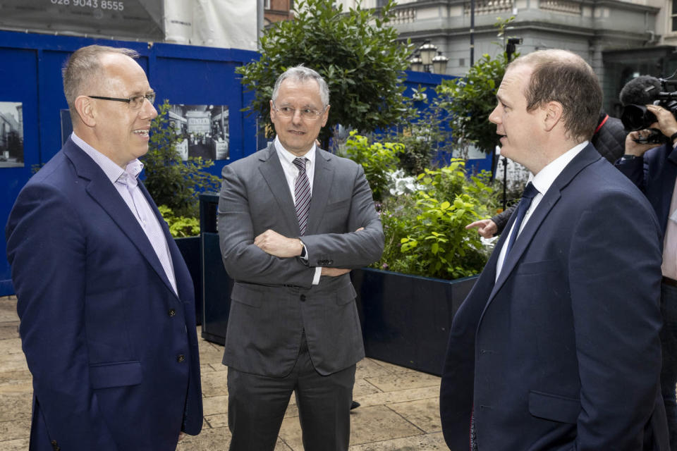 (L to R) Agio chief revenue officer Garvin McKee, Invest NI chief executive Kevin Holland and Economy Minister Gordon Lyons outside Invest NI in Belfast (Liam McBurney/PA)