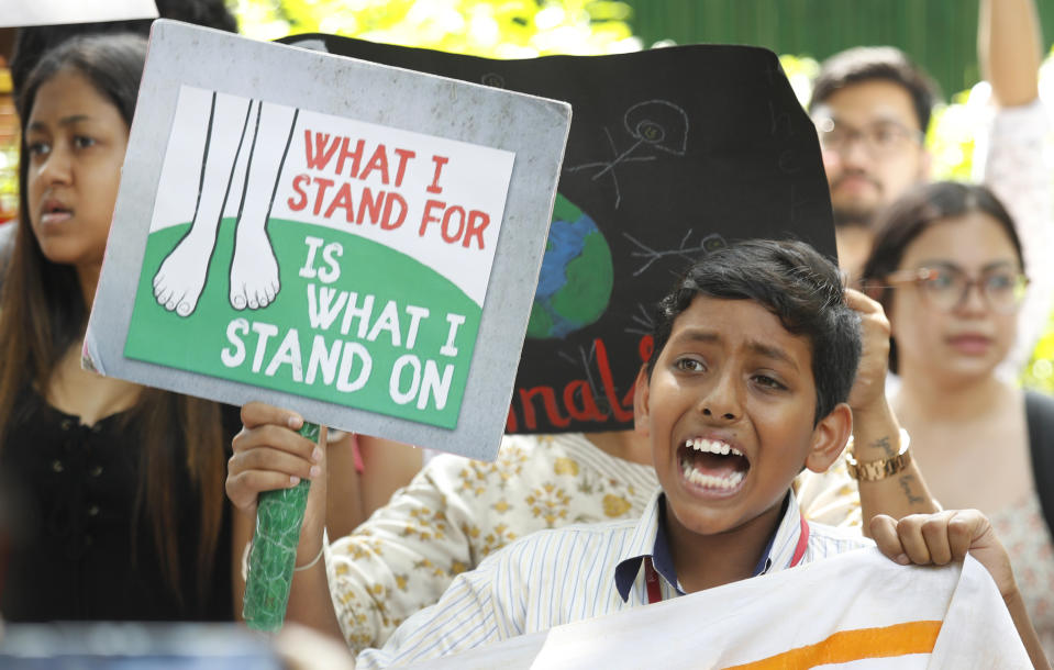A young protester shouts slogans with others in front of the Ministry of Housing and Urban Affairs in New Delhi, India, Friday, Sept. 20, 2019. The protestors gathered in response to a day of worldwide demonstrations calling for action to guard against climate change began ahead a U.N. summit in New York. (Photo: Manish Swarup/AP)