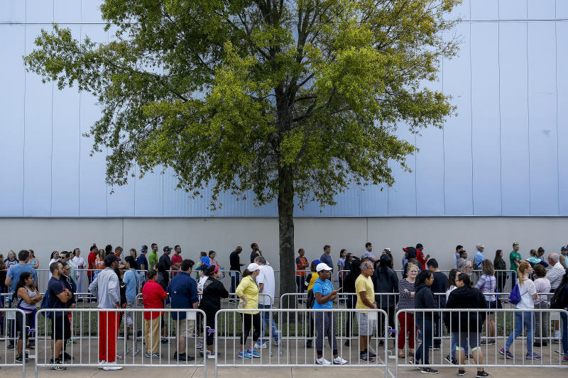 People line up to volunteer at NRG Center, which opened its doors to evacuees in the wake of Tropical Storm Harvey, on Wednesday in Houston. (AP)