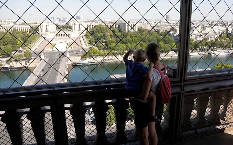 People visit the Eiffel Tower in Paris on its reopening to the public following the coronavirus disease. - Charles Platiau