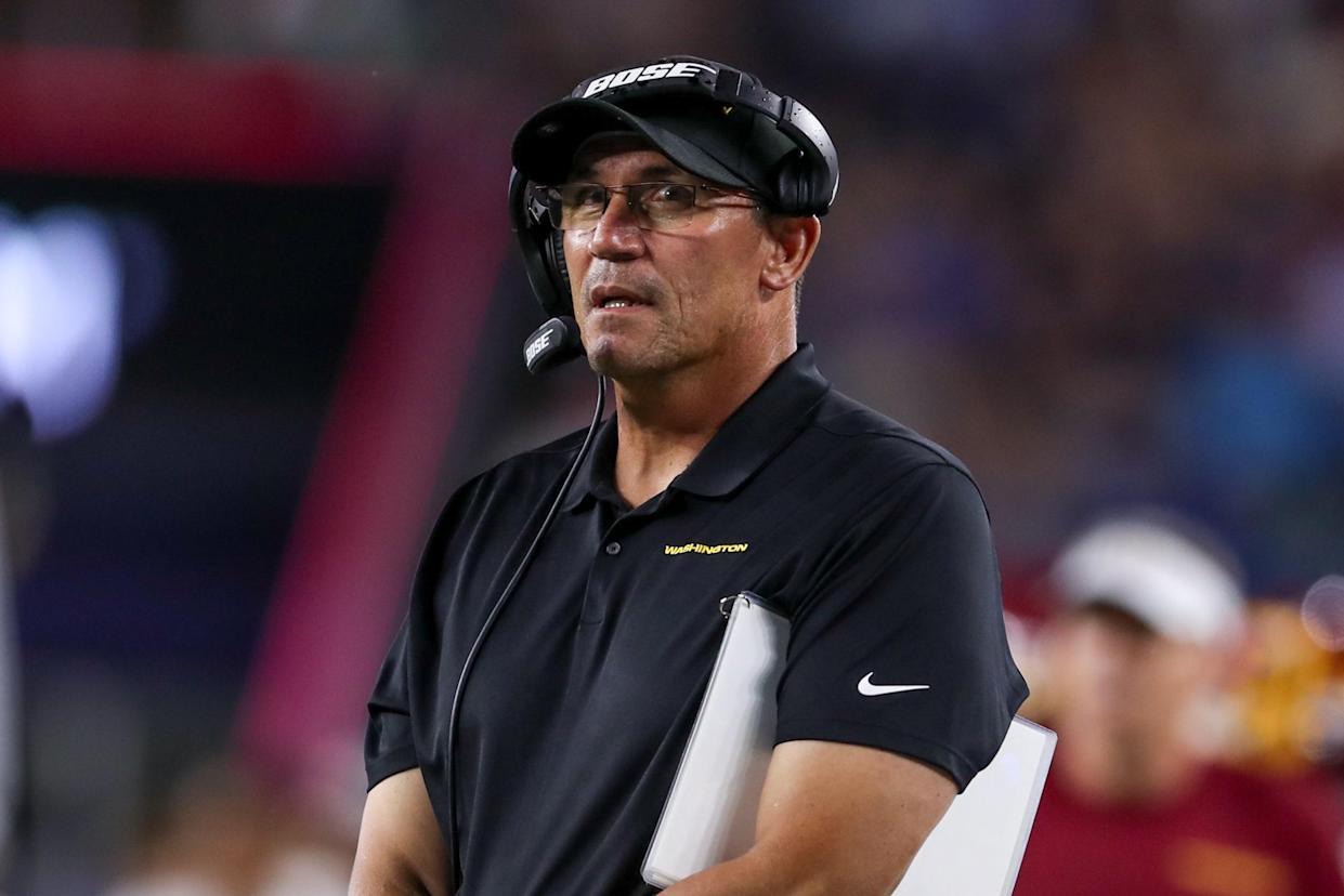 Ron Rivera looks on during the first half against the New England Patriots at Gillette Stadium.