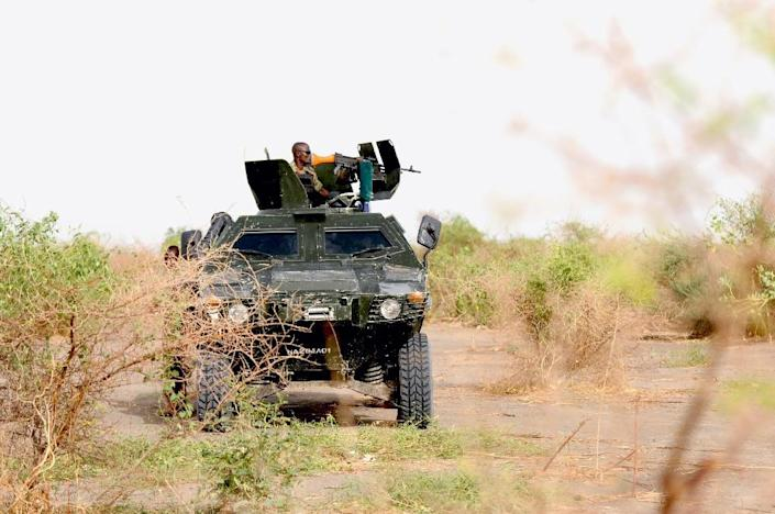 Nigerian soldiers patrol in Borno state on June 13, 2015, close to a former Boko Haram camp (AFP Photo/Quentin Leboucher)