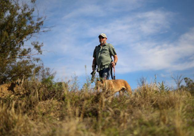 A game range with his dog doing anti poaching work (Photo: CarlFourie via Getty Images)