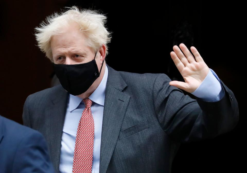 Britain's Prime Minister Boris Johnson wears a face mask or covering due to the COVID-19 pandemic, as he leaves 10 Downing Street in central London on September 30, 2020 to attend the weekly Prime Minister's Questions (PMQs) session in the House of Commons. (Photo by Tolga AKMEN / AFP) (Photo by TOLGA AKMEN/AFP via Getty Images)