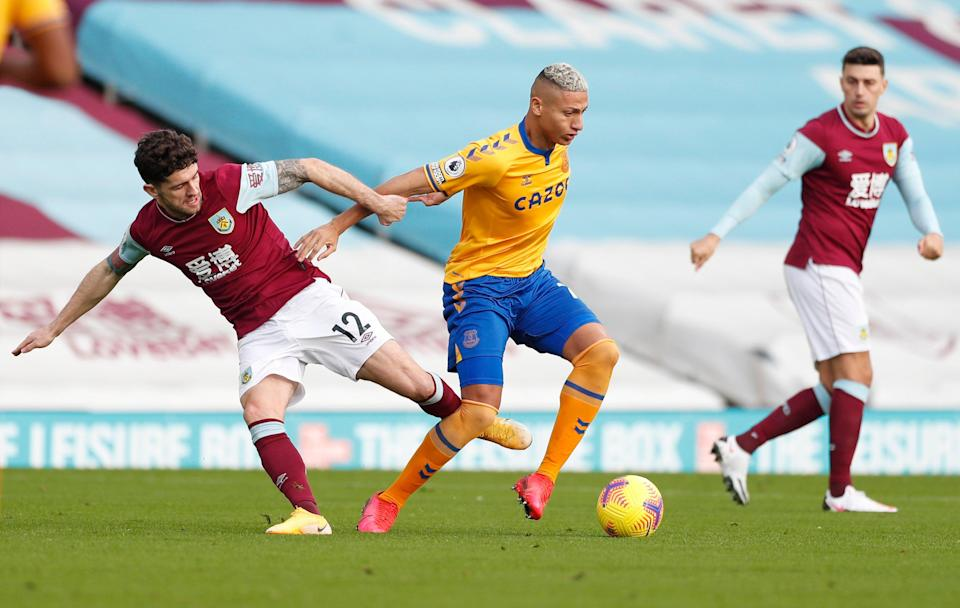 <p>Richarlison holds off Robbie Brady in midfield</p> (Reuters)
