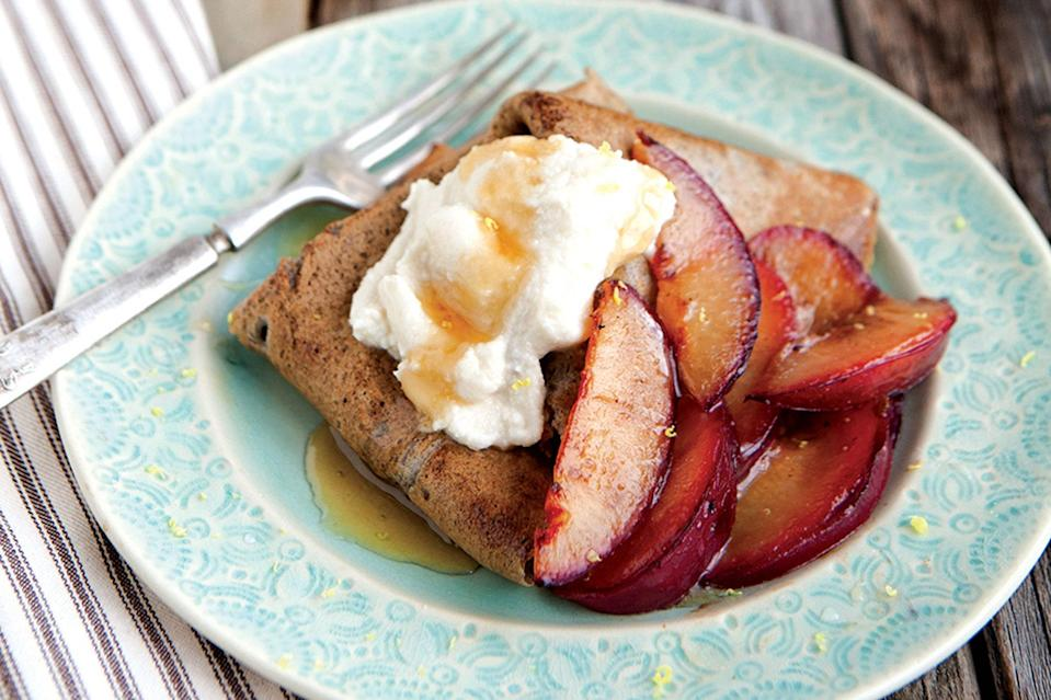 """Serve these nutty crepes for dessert or a breakfast treat—either way you'll win. <a href=""""https://www.epicurious.com/recipes/food/views/buckwheat-crepes-with-honeyed-ricotta-and-sauteed-plums-51195420?mbid=synd_yahoo_rss"""" rel=""""nofollow noopener"""" target=""""_blank"""" data-ylk=""""slk:See recipe."""" class=""""link rapid-noclick-resp"""">See recipe.</a>"""