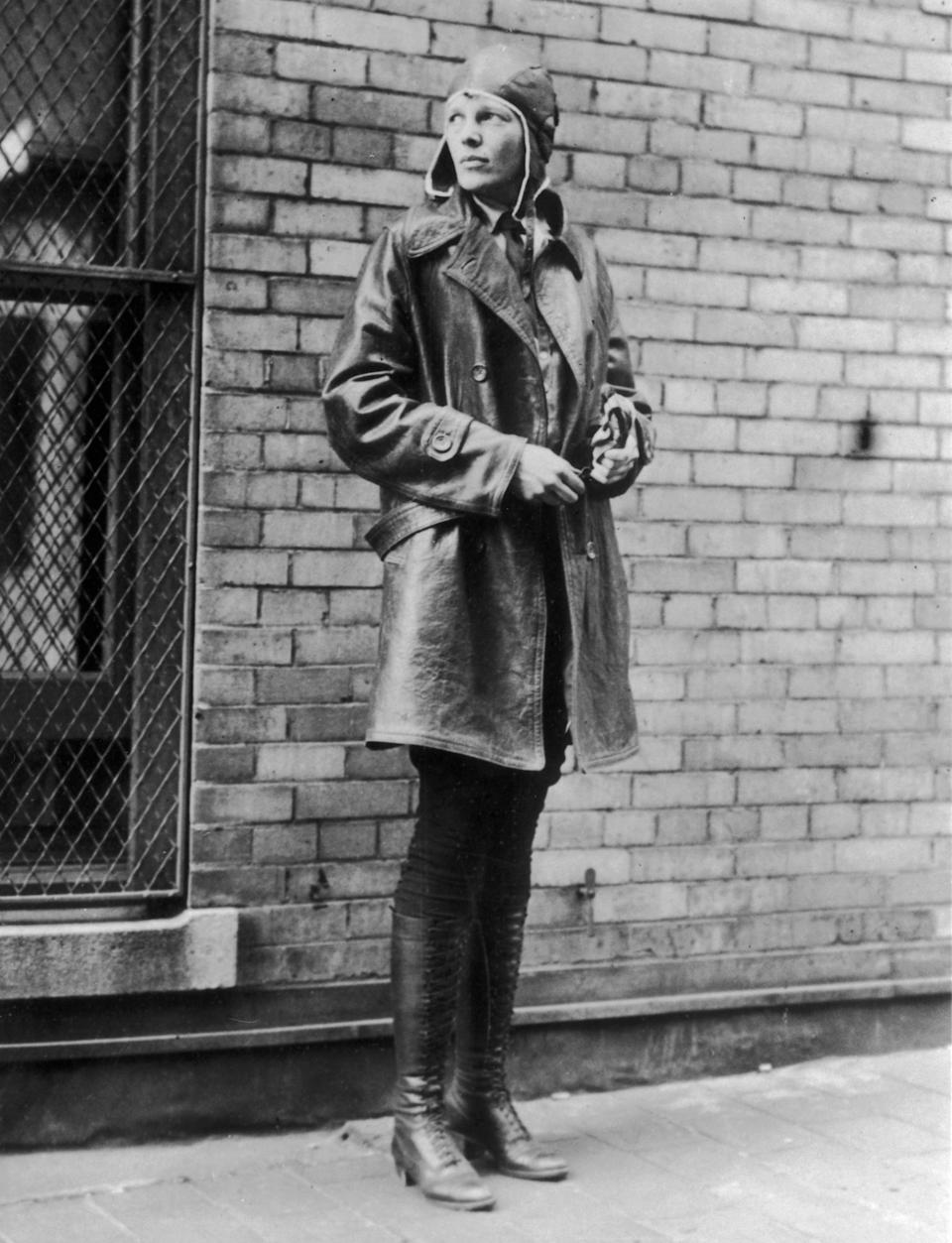 Aviatrix Amelia Earhart (1898 – 1937) in Newfoundland. Noted for her flights across the Atlantic and Pacific oceans, Earhart disappeared without trace in her attempt to fly around the world. (Photo by Topical Press Agency/Getty Images)