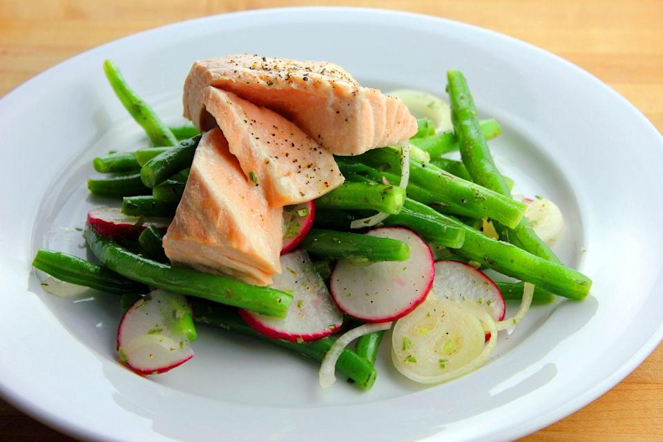 """<p>When paired with lemon slices, herbs, and wine or broth in place of water, this salmon will only smell of delicious aromatics. You can add these silky, tender bites of salmon <a href=""""https://www.goodhousekeeping.com/food-recipes/healthy/g180/healthy-salads/"""" rel=""""nofollow noopener"""" target=""""_blank"""" data-ylk=""""slk:into a quick salad"""" class=""""link rapid-noclick-resp"""">into a quick salad</a> or even atop cold noodles. Got 8 minutes? You have perfectly poached salmon!</p><p><em><a href=""""https://www.goodhousekeeping.com/food-recipes/a10196/micro-poached-salmon-recipe-ghk0610/?click=recipe_sr"""" rel=""""nofollow noopener"""" target=""""_blank"""" data-ylk=""""slk:Get the recipe for Micro-Poached Salmon"""" class=""""link rapid-noclick-resp"""">Get the recipe for Micro-Poached Salmon</a> »</em></p>"""