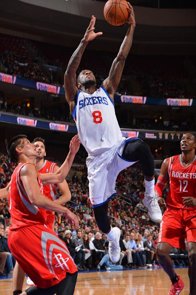 PHILADELPHIA, PA - NOVEMBER 13: Tony Wroten #8 of the Philadelphia 76ers drives to the basket against Jeremy Lin #7 of the Houston Rockets at the Wells Fargo Center on November 13, 2013 in Philadelphia, Pennsylvania. (Photo by Jesse D. Garrabrant/NBAE via Getty Images)