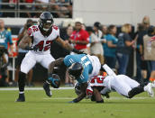 Jacksonville Jaguars wide receiver Marqise Lee (11) is injured as he is tackled by Atlanta Falcons cornerback Damontae Kazee, right, and linebacker Duke Riley (42) during the first half of an NFL preseason football game, Saturday, Aug. 25, 2018, in Jacksonville, Fla. Lee was taken off the field on an medical cart after the play. (AP Photo/Stephen B. Morton)