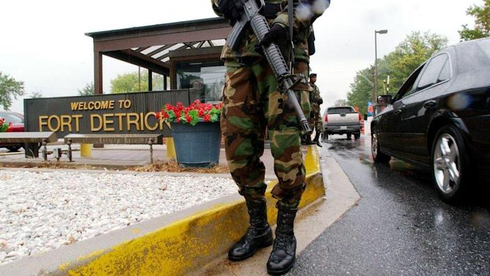 Military personnel stand guard outside the US Army Infectious Disease Institute for Medical Research at Fort Detrick