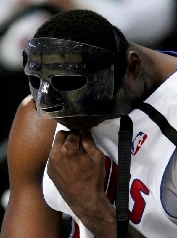 FILE PHOTO: Detroit Pistons' Antonio McDyess sits on the sideline during the second quarter of their 94-80 defeat by the Boston Celtics in Game 3 of the NBA Eastern Conference Finals.