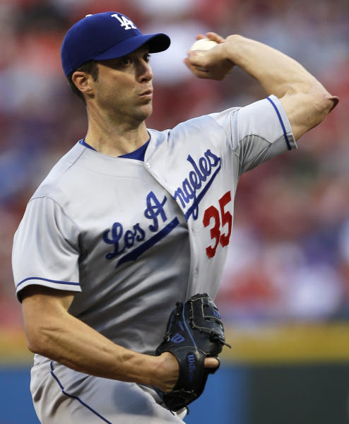 Los Angeles Dodgers starting pitcher Chris Capuano throws to a Cincinnati Reds batter in the first inning of a baseball game, Friday, Sept. 6, 2013, in Cincinnati. (AP Photo/Al Behrman)