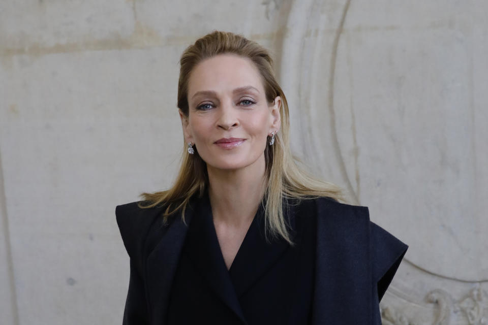 Actress Uma Thurman poses before Dior Haute Couture Spring/Summer 2020 fashion collection, Monday Jan.20, 2020 in Paris (AP Photo/Christophe Ena)
