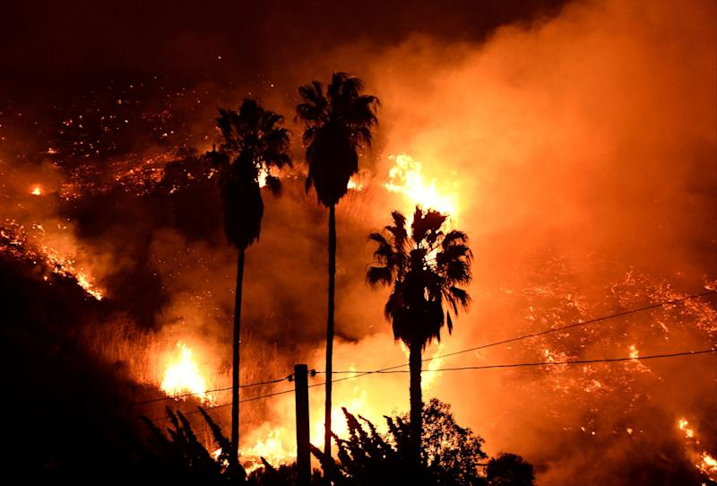 Flames spread throughout a large area of Ventura County, driven by powerful Santa Ana winds that are expected to last for days.