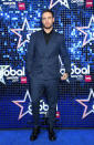 <p>Liam Payne chose a dapper navy double-breasted suit for the annual star-studded ceremony. <em>[Photo: Getty]</em> </p>