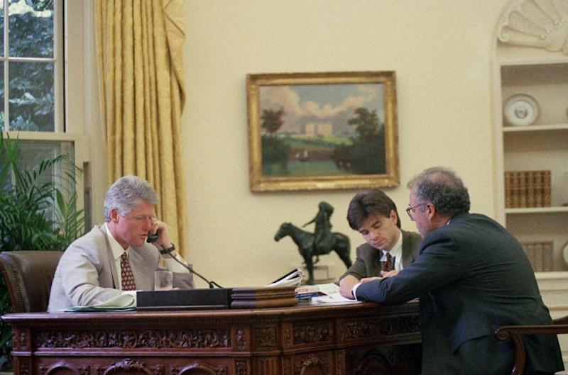 FILE - In this Aug. 5, 1993 file photo taken by an Associated Press photographer, President Bill Clinton meets with members of his senior staff, George Stephanopoulos, center, and Howard Paster, director for legislative affairs, in the Oval Office in Washington. As of Thursday, Nov, 21, 2013, White House-based photographers have not been permitted to make a picture of President Barack Obama meeting with his staff in the Oval Office. (AP Photo/Dennis Cook, File)