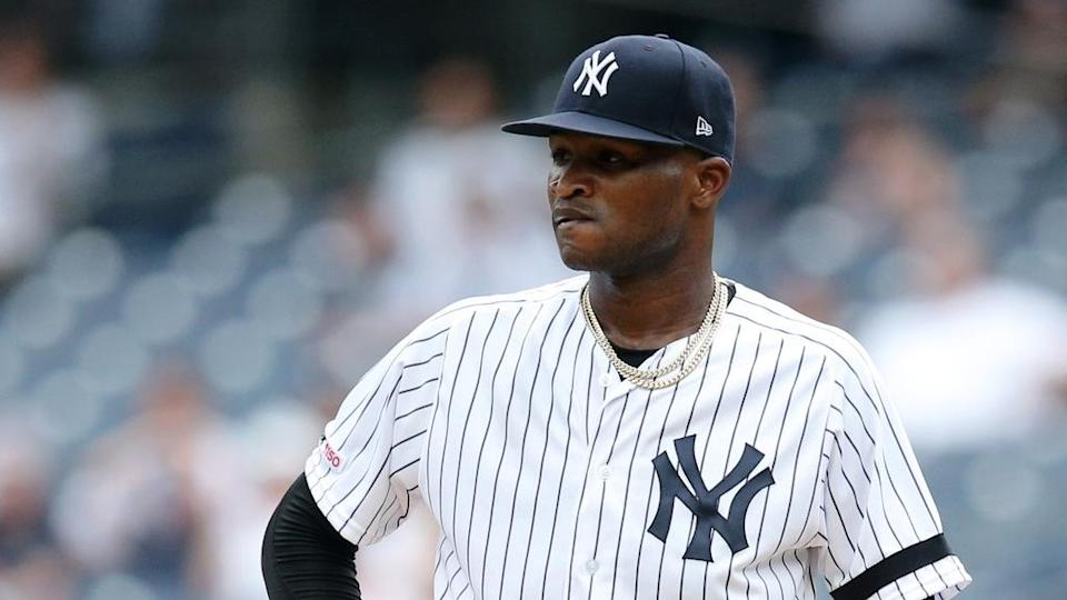 Domingo German stands stoic on the mound