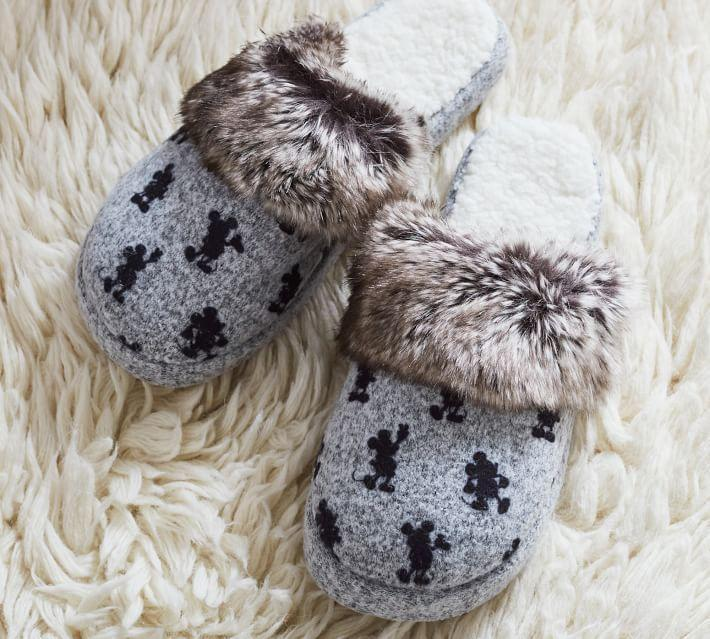 """<p>potterybarn.com</p><p><strong>$39.50</strong></p><p><a href=""""https://go.redirectingat.com?id=74968X1596630&url=https%3A%2F%2Fwww.potterybarn.com%2Fproducts%2Fmickey-fur-trimmed-slippers%2F&sref=https%3A%2F%2Fwww.countryliving.com%2Fshopping%2Fgifts%2Fg34122456%2Fgifts-for-disney-lovers%2F"""" rel=""""nofollow noopener"""" target=""""_blank"""" data-ylk=""""slk:Shop Now"""" class=""""link rapid-noclick-resp"""">Shop Now</a></p><p>These faux fur-trimmed slippers feature vintage Mickey silhouettes, perfect for any Mickey-lover on your list.</p>"""