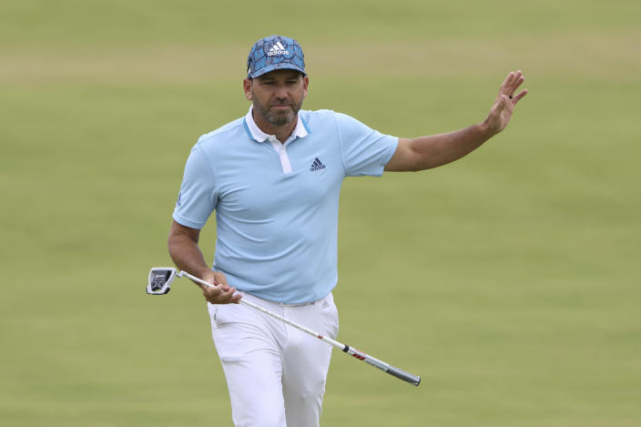 Spain's Sergio Garcia acknowledges the crowd as he walks onto the 18th green during the first round British Open Golf Championship at Royal St George's golf course Sandwich, England, Thursday, July 15, 2021. (AP Photo/Ian Walton)