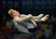 Andrew Capobianco of United States competes in men's diving 3m springboard final at the Tokyo Aquatics Centre at the 2020 Summer Olympics, Tuesday, Aug. 3, 2021, in Tokyo, Japan. (AP Photo/Dmitri Lovetsky)