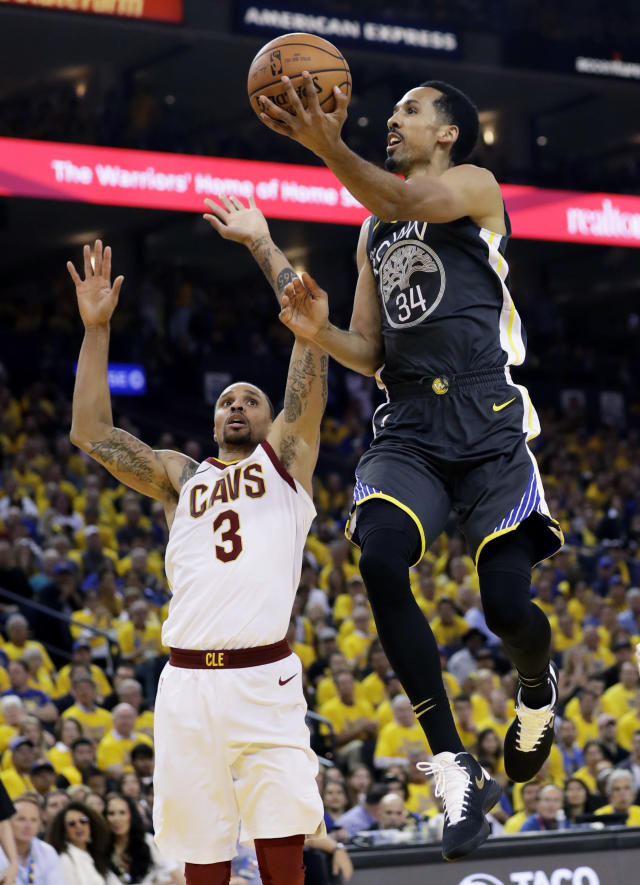 Golden State Warriors guard Shaun Livingston (34) shoots against Cleveland Cavaliers guard George Hill (3) during the first half of Game 2 of basketball's NBA Finals in Oakland, Calif., Sunday, June 3, 2018. (AP Photo/Marcio Jose Sanchez)