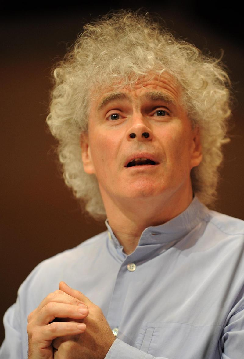 FILE - In this April 22, 2006 file picture  Sir Simon Rattle, speaks at a press  conference in Berlin. British conductor Simon Rattle will leave his post as the artistic director of the Berlin Philharmonic when his contract ends in 2018. Rattle says he will be 64 by then and wants to make room for someone else to take over after 16 years as chief conductor. He said in a statement Thursday Jan 10, 2013  that he wanted to give the German capital's renowned orchestra enough time to find a successor over the coming five years.  (AP Photo/dapd/ Berthold Stadler,File)