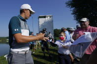 Jordan Spieth signs autographs while walking to the 13th tee box during the ProAm at the BMW Championship golf tournament, Wednesday, Aug. 25, 2021, at Caves Valley Golf Club in Owings Mills, Md. The BMW Championship tournament begins Thursday. (AP Photo/Julio Cortez)