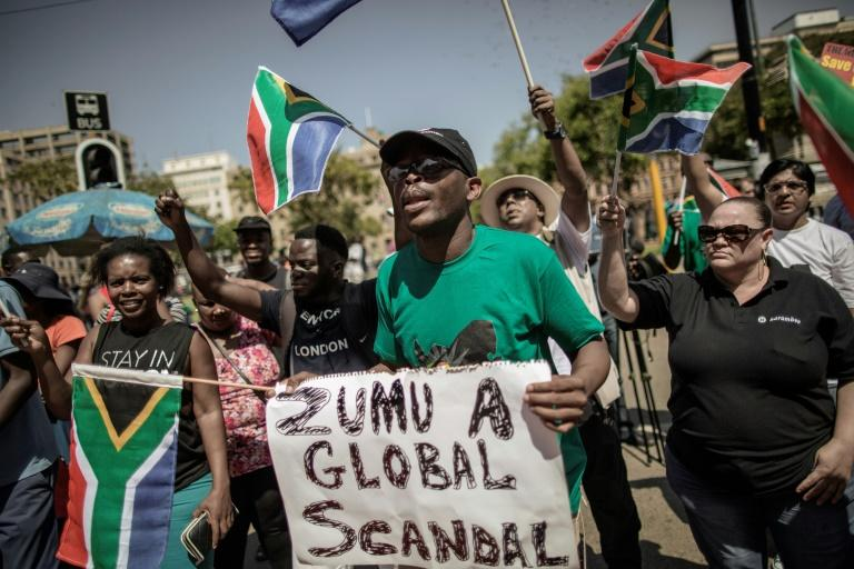 Activists and protesters demonstrate in support of axed Finance minister Pravin Gordhan outside the South African National treasury on March 31, 2017 in Pretoria