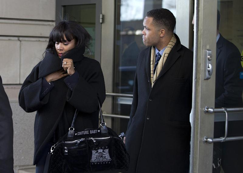 FILE - In this Feb. 20, 2013 file photo, former Illinois Rep. Jesse Jackson Jr. and his wife Sandi leave federal court in Washington. Prosecutors are recommending four years in prison for Rep. Jesse Jackson Jr., following his guilty plea this year on criminal charges that he engaged in a scheme to spend $750,000 in campaign funds on personal items. The government is also recommending that Jackson be ordered to pay $750,000 in restitution to the campaign, and forfeit $750,000. He is scheduled to be sentenced on July 3, along with his wife, Sandra. She pleaded guilty to filing false joint federal income tax returns that knowingly understated the income the couple received. (AP Photo/Evan Vucci, File)